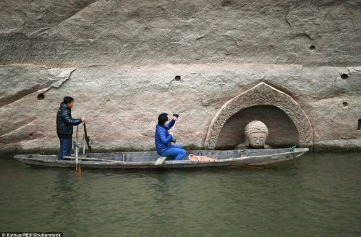 Ancient Buddha Statue Emerges From Lake After Water Lowers By 30 Feet