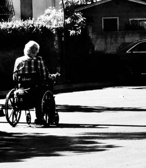 Wheeling Backwards: What it's like to Roll in a Wheelchair (Poem)