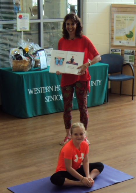 Author And Featured Model In A Children's Book Reading/Demonstration