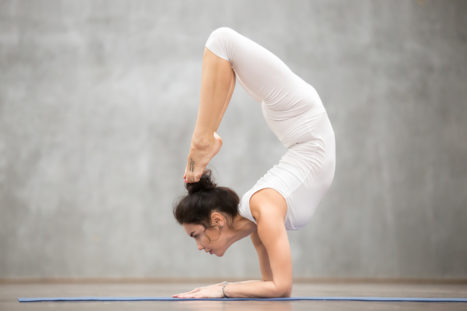 5 Ways I Conquered Scorpion Pose At Age 50